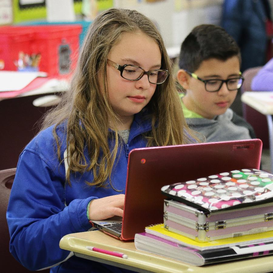 Two middle-school students at desks