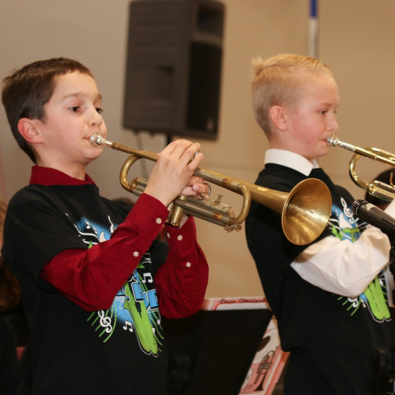 Two boys playing trumpets