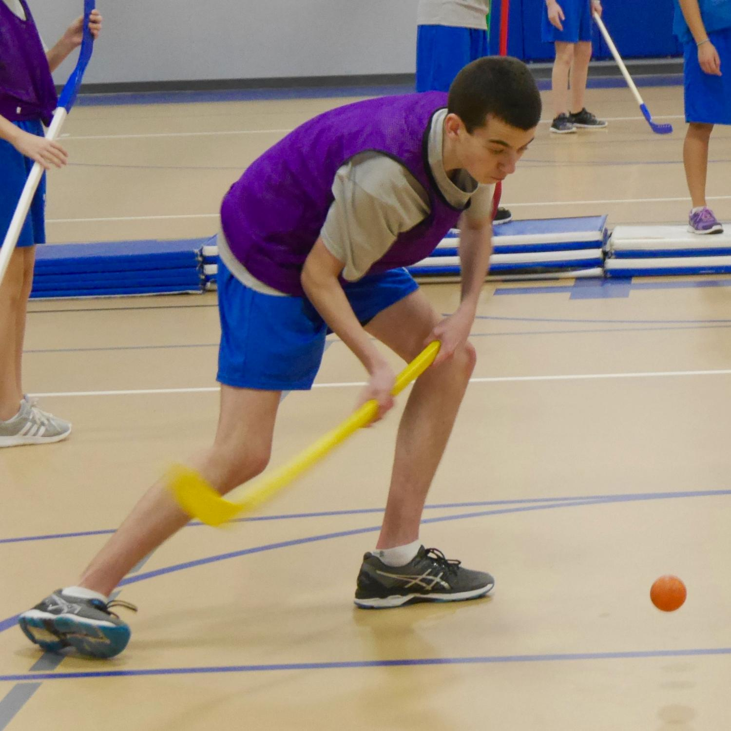 Boy playing floor hockey