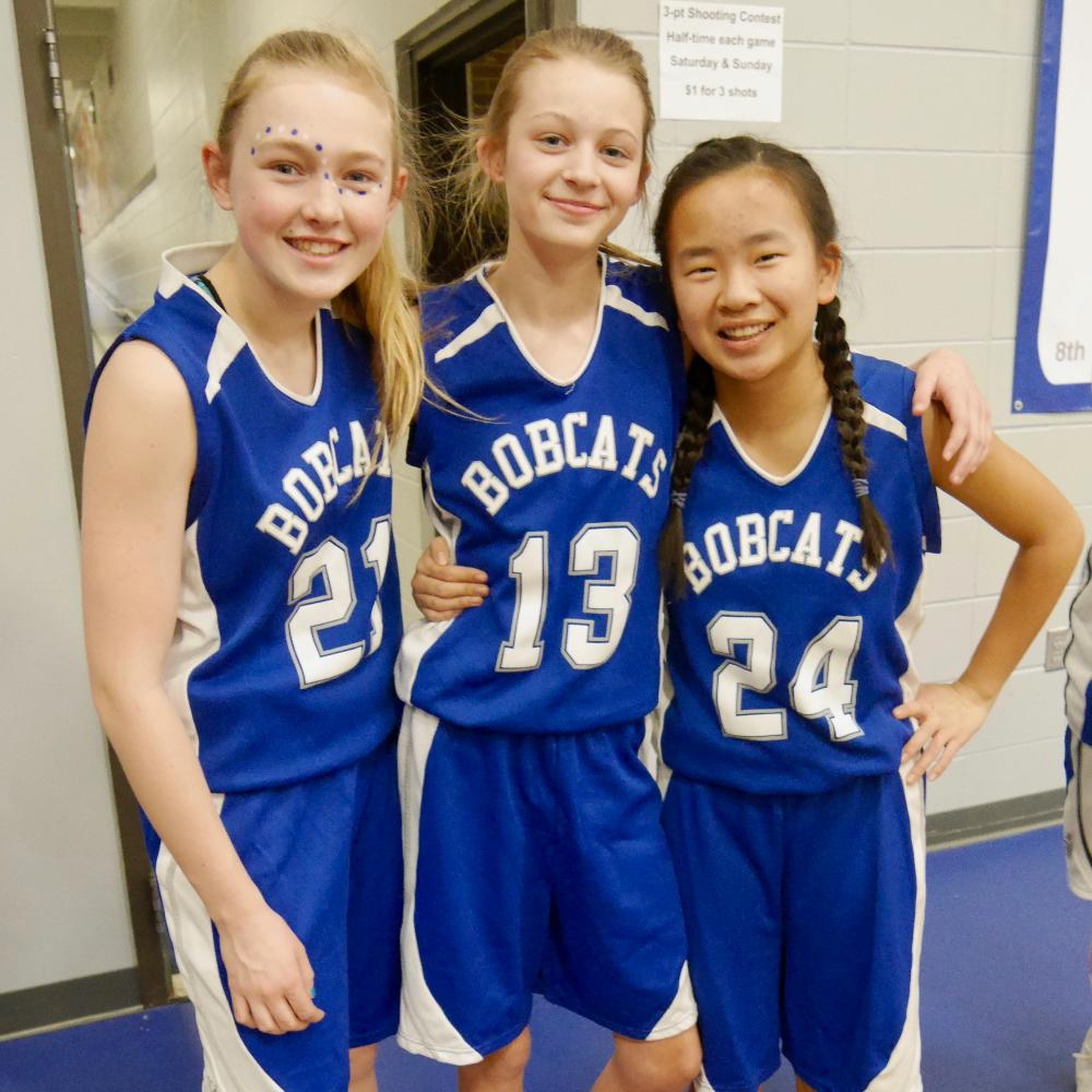 Three basketball girls smiling