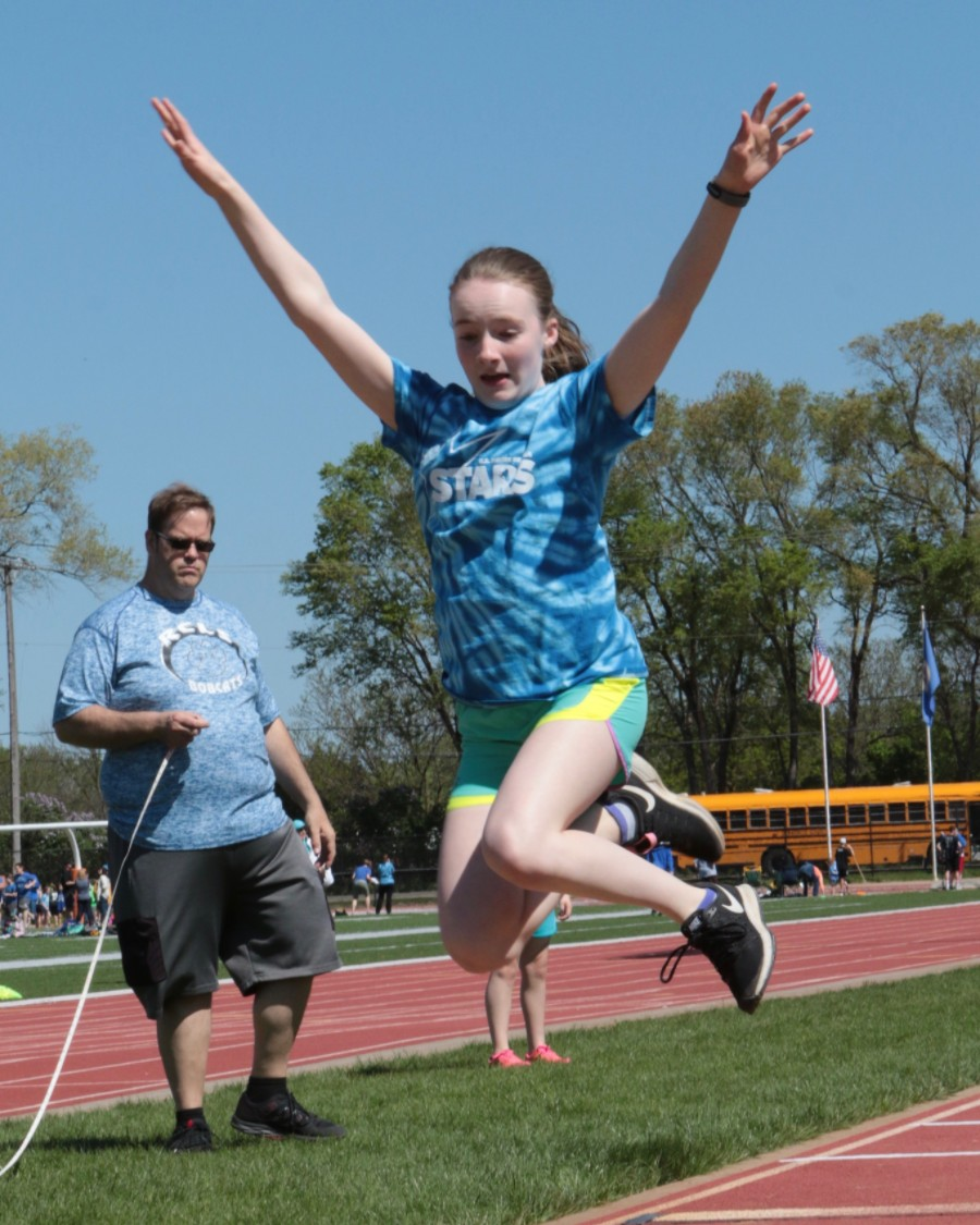 Girl doing long jump