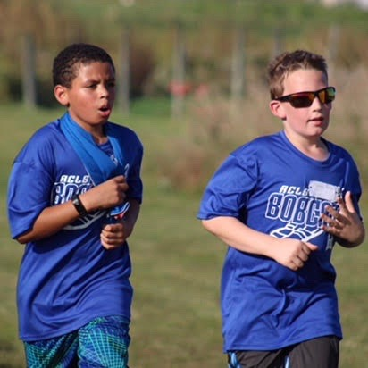 Two boys running in cross-country meet