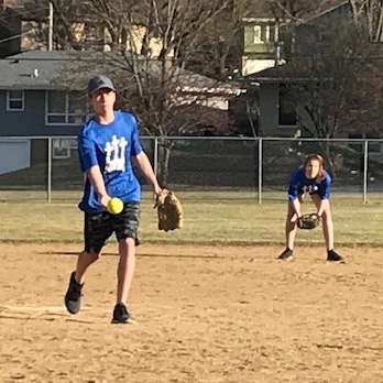 Boy pitching a softball
